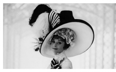 In My Fair Lady, a professor takes it upon himself to transform a working class girl (Audrey Hepburn) into a society woman. What does that include? Of course, grand hats in every hue!